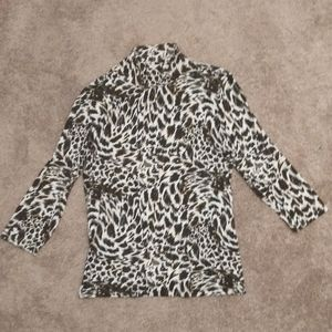 Emma James (L) turtleneck cheetah / leopard